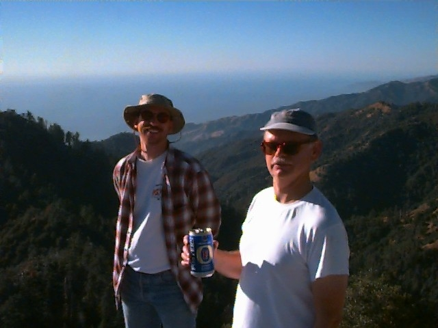 The LosPadres.info webmaster (left) and counsel review the current state of affairs atop 5,155 foot-tall Cone Peak on a sunny day in December 1998.